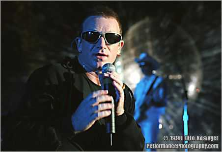 Live concert photo of Bono, The Edge (bg)