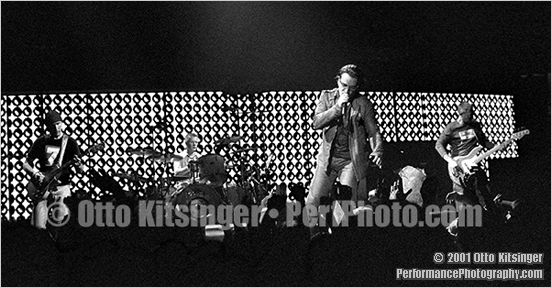 Live U2 concert photo of The Edge, Larry Mullen Jr, Bono, Adam Clayton