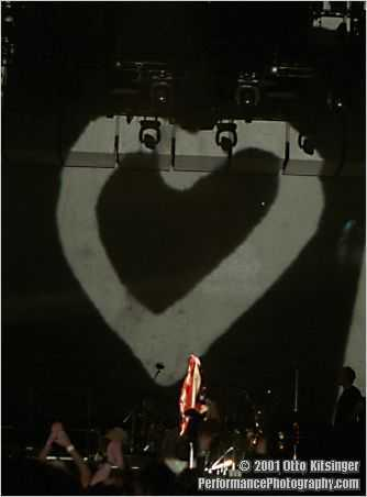 Live concert photo of flag jacket and heart (inside suitcase)