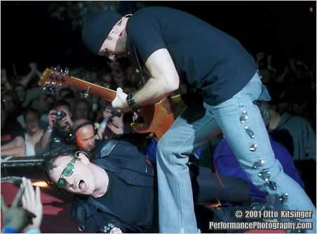 Live U2 concert photo of Bono, The Edge