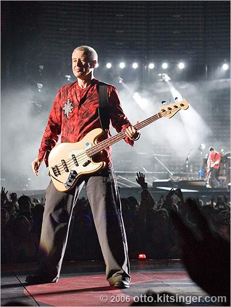 Live concert photo of Adam Clayton, The Edge (bg)