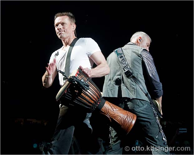 Live U2 concert photo of Larry Mullen Jr, Adam Clayton