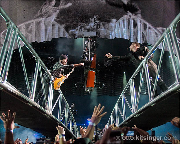 Live U2 concert photo of The Edge, Bono