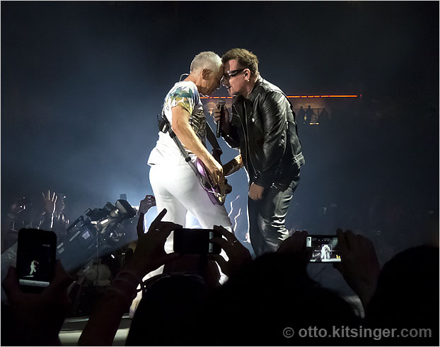 Live U2 concert photo of Adam Clayton, Bono