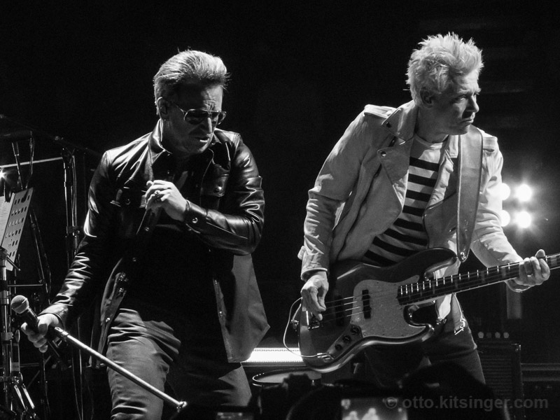 Live concert photo of Bono, Adam Clayton