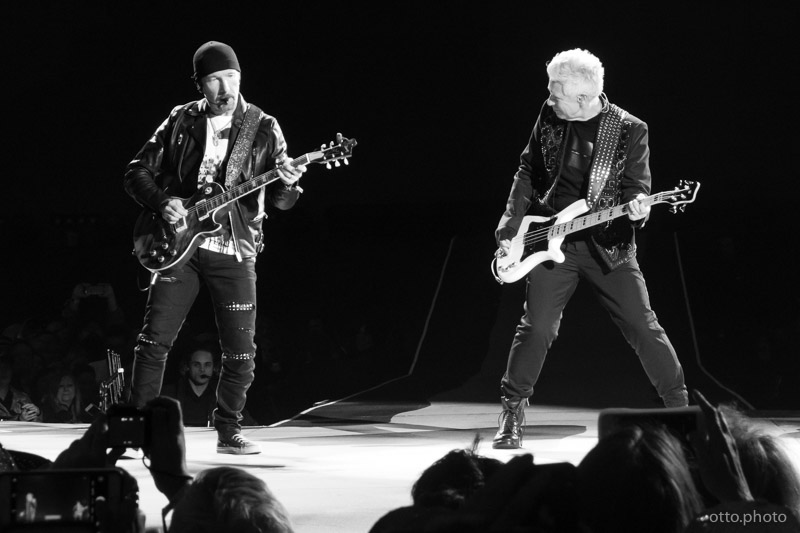 Live concert photo of The Edge, Adam Clayton